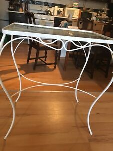 White metal glass topped table
