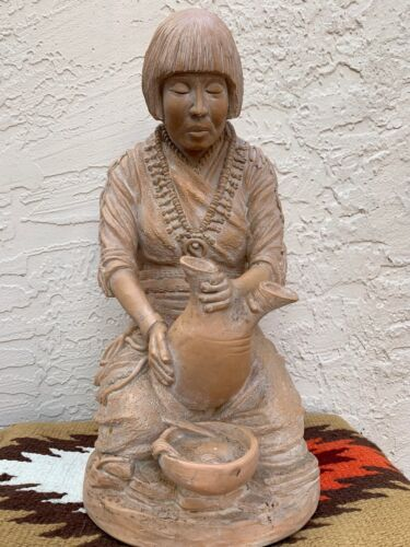 1983 FLORENTINE ART POTTERY OF A NATIVE AMERICAN WOMAN WORKING ON CLAY