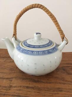 Vintage retro blue and white rice grain china tea pot.