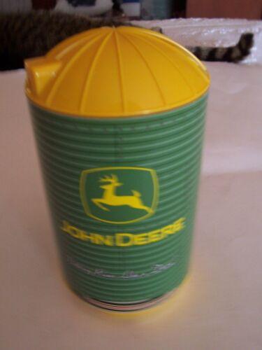 LARGE LOT JOHN DEERE CARDBOARD DRINK COASTERS IN YELLOW AND GREEN PLASTIC SILO