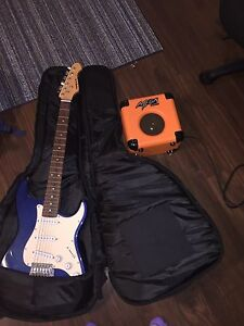 blue electric guitar with case and amp