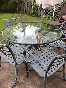 Cast Iron Table and Four Chairs