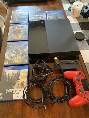 ps4 console with games and controller