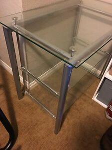 Glass table with shelves