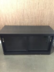 Dark brown TV stand - solid glass case