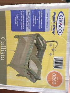 Graco play pen with change table and mobile