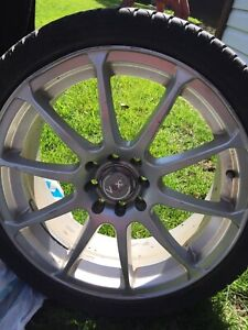 Dunlop tires and voxx racing rims for sale