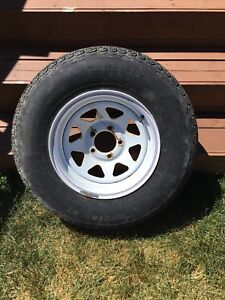 One ST 215/75 R14 trailer tire and rim