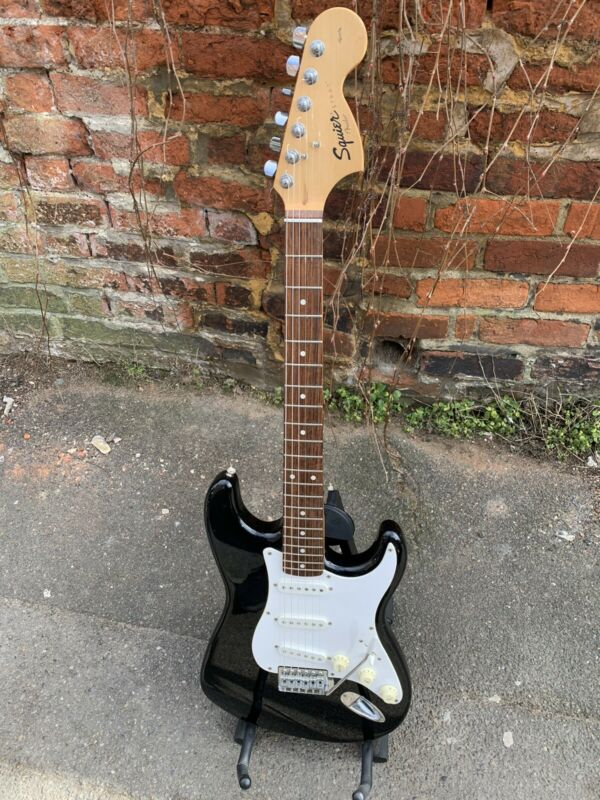 FENDER SQUIER STRATOCASTER. JET BLACK. STUNNING! with CASE.