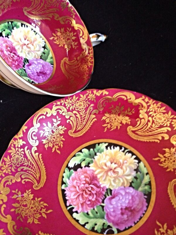 Stunning paragon tea cup Red ground with Gold Intricate Guilding And Mums