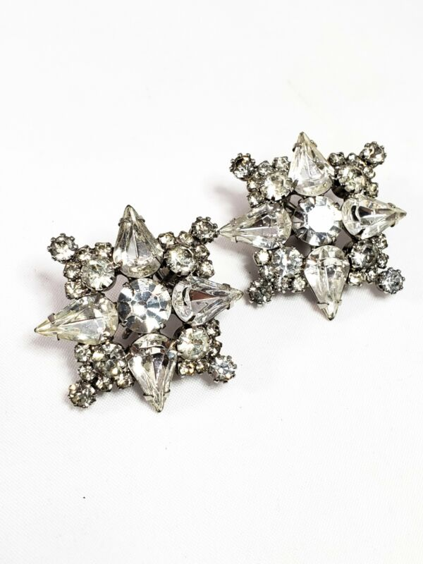 Vintage bright clear rhinestone snowflake clip on mid century earrings