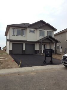 Pay 750 First Month 2 bedroom in Pilot Butte with garage.