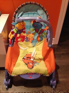 Toddlers play chair