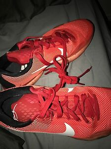 Kobe red and black Nike basketball shoes