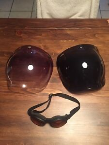 Scooter helmet, snap on face shields.