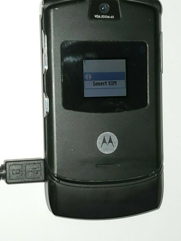Motorola V3 RAZR Cell Phone with charger Battery not working