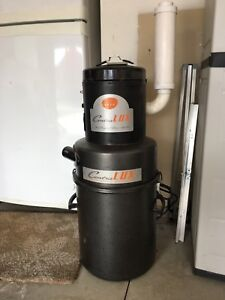 Electolux central vacuum with attachments.