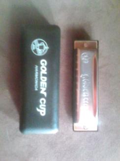 Golden cup harmonica