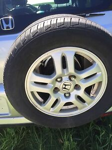 "15"" Honda CRV rims and tires."