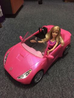 Barbie doll with car