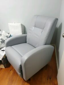 Grey leather recliner/rocking chair.