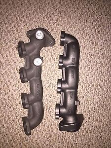 1997-2003 4.6L exhaust manifolds with gaskets.
