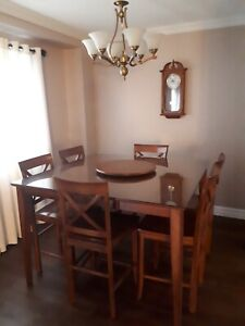 Large square wood table with glass cover, turn table & 8 chairs
