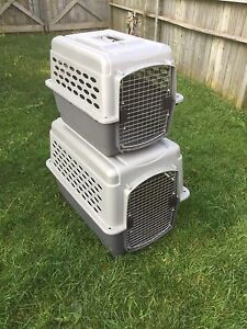 Large and medium Pet Mate brand sky crate