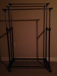 ROLLING ADJUSTING CLOTHING RACK