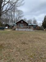 Square timber home for sale on Lake Huron $429,000