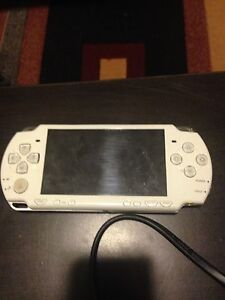 Psp with 3 games and charger