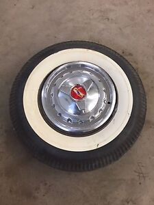 White wall tires& hub caps from 1957 bel air