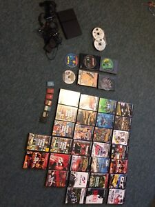 Ps2 slim, 2 controllers, 7 memory cards, 35 games