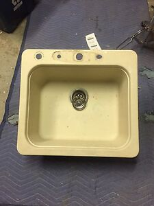 Granite kitchen sink with mounts and soap dispenser