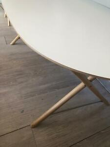Oval white dining table