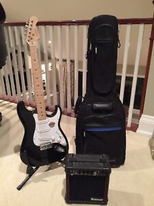 Electric guitar with amp and case
