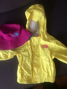 North Face rain jacket and sun hat
