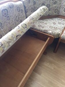Solid wood with upholstered benches with storage.