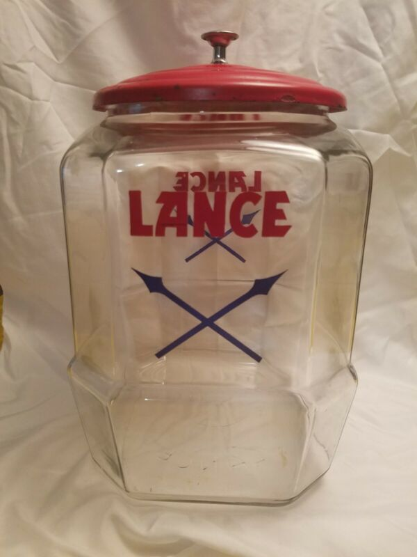 VINTAGE LANCE JAR  pre-owned. 11inches high 7 inches wide. 9 inches deep.