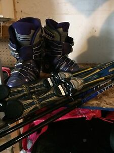 Women's size 8 ski boots poles and skies