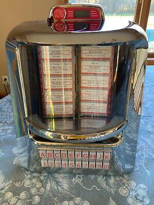 Jukemaster 100 by Tyrell retro table top juke box, diner juke box.