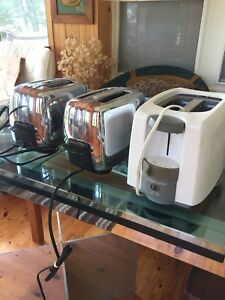 Two vintage general electric toasters and one regular toaster
