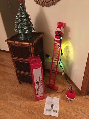 Animated Climbing Santa / Stepping Santa Wondershop in Box Christmas decoration