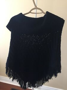 Woman's black knitted poncho