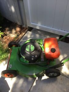 Vintage  commercial two stroke law boy mower.