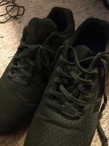 Worn once quilted black Adidas shoes