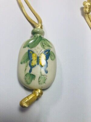 VINTAGE AVON PAINTED PORCELAIN BUTTERFLY NECKLACE ON CORD