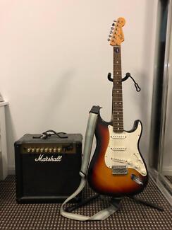 Fender Stratocaster guitar including marshall amp