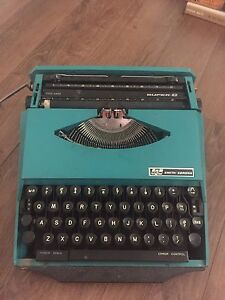 Used good condition turquoise typewriter