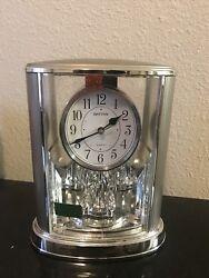 Rhythm Cont Mantel Table Rotating Pendulum Clock in silver